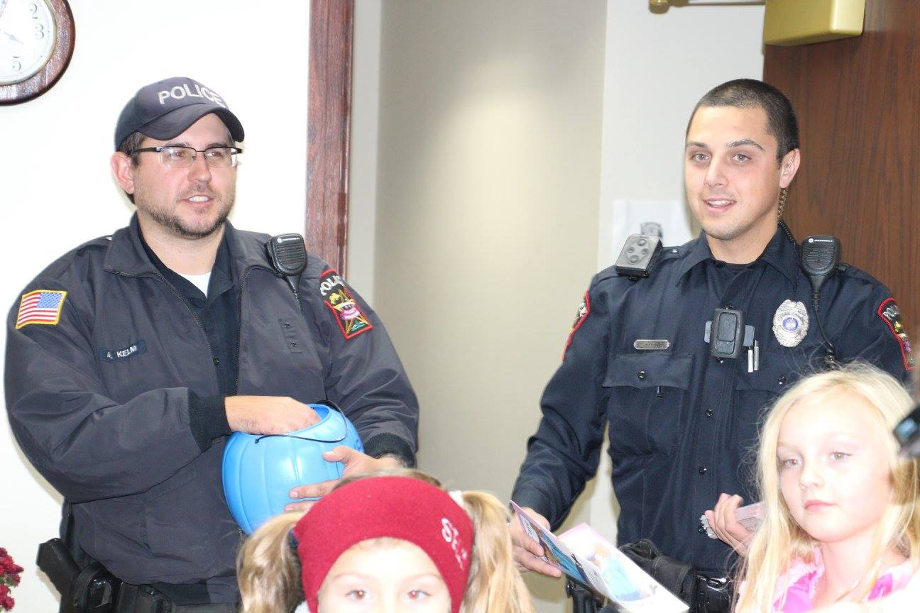 Police officers handing out Trick or Treating sweets