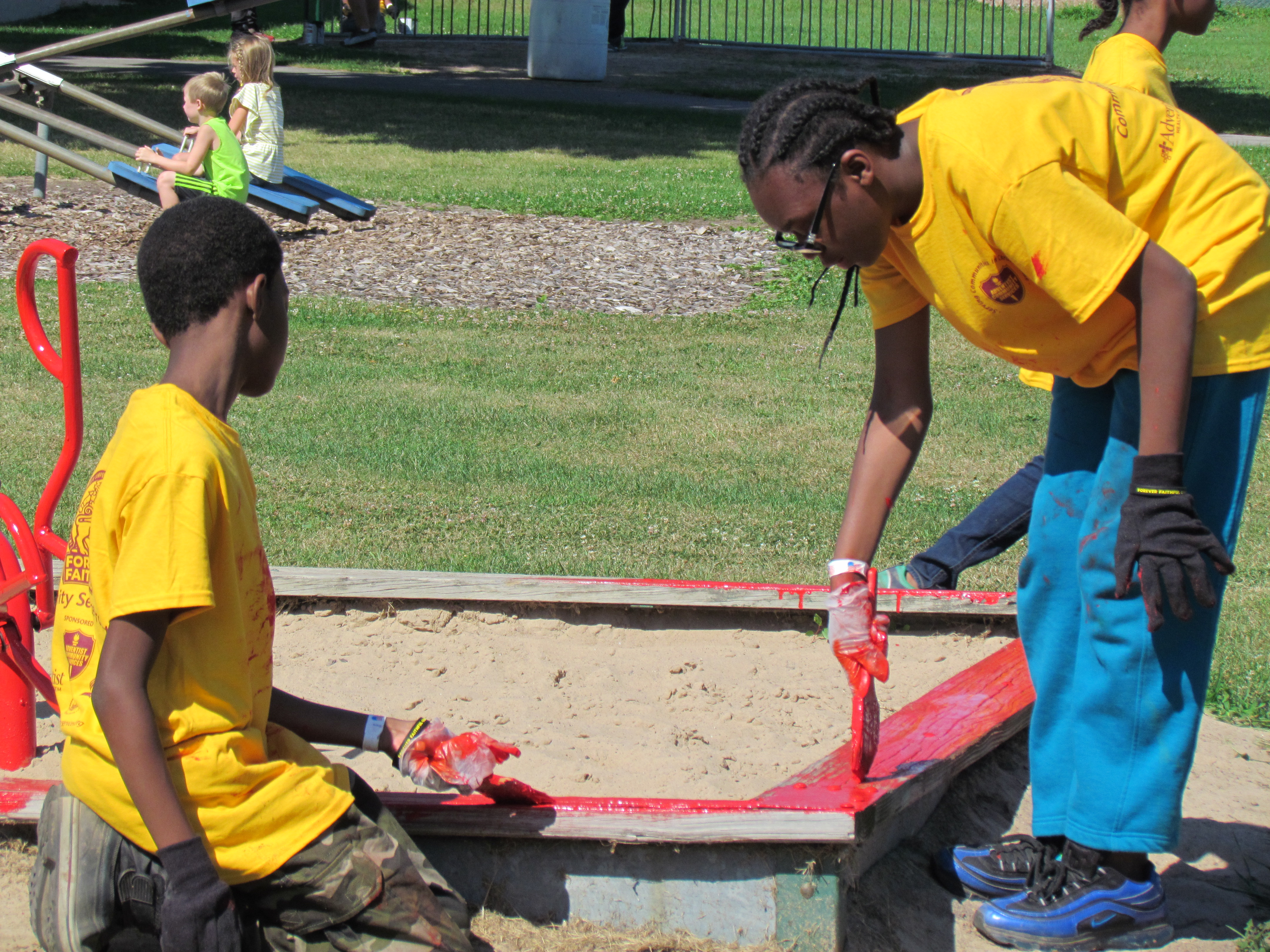 Bronx, NY Pathfinders Painting a Sand Box